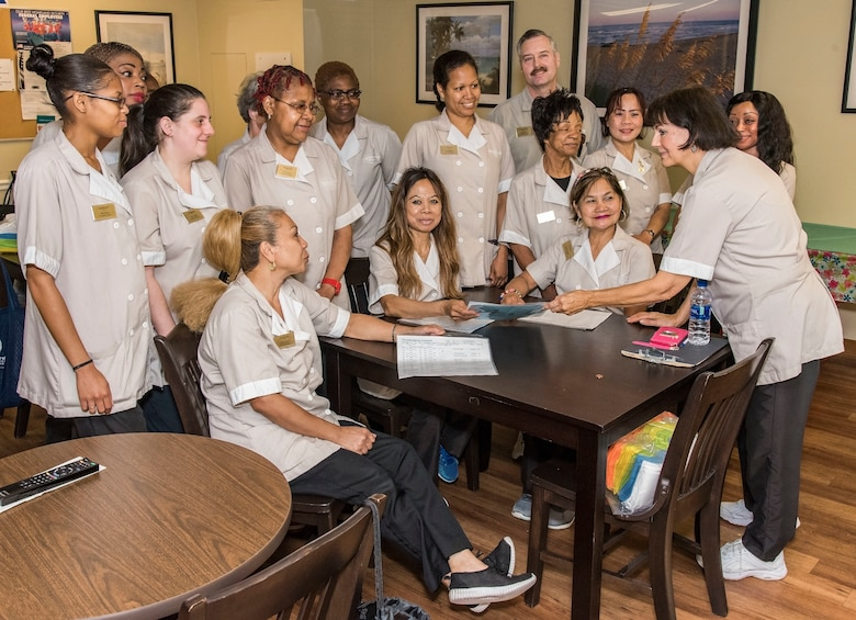 Marti Hosterman, right, 436th Force Support Squadron lodging custodial worker supervisor, hands out work assignments to housekeeping staff Aug. 7, 2018, at the Eagle's Rest Inn on Dover Air Force Base, Del. Hosterman is vying for the 2018 Innkeeper Travelers' Award that is scheduled to be presented later this year at the Lodging Managers Leadership Training, Scott Air Force Base, Ill. (U.S. Air Force photo by Roland Balik)