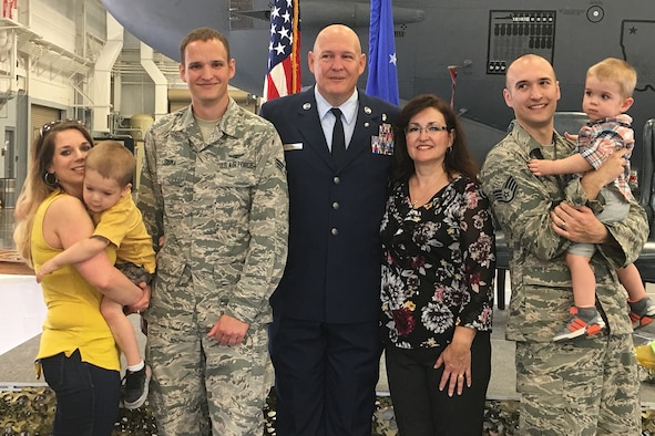 PETERSON AIR FORCE BASE, Colo. – Staff Sgt. Jordan Cisna, 21st Medical Group aerospace medical technician, stands with his wife and family in front of a C-130 after his father's retirement ceremony at Barksdale Air Force Base, Louisiana, Nov. 3, 2017. The Cisna family has been serving in the Air Force since its inception in 1947. (Courtesy photo)