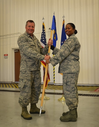 Maj. Katrina Jones assumes command of the 94th Maintenance Squadron during a change of command ceremony on August 5, 2018 at Dobbins Air Reserve Base. The 94th MXS guide on flag is exchanged from group commander to new unit commander to symbolize the assumption of leadership.  (U.S. Air Force photo by Senior Airman Lauren Douglas)