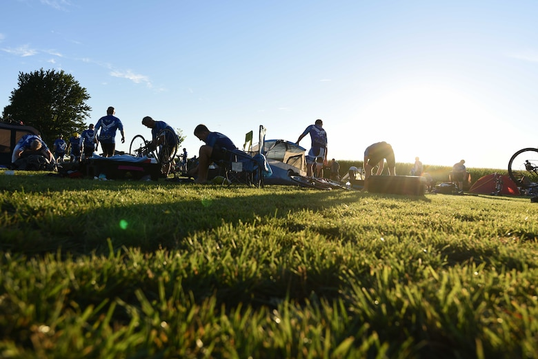 Team Dakota members help set up camp in Jefferson, Iowa, July 24, 2018. Team Dakota and the Air Force Cycling Team participated in the Register's Annual Great Bicycle Ride Across Iowa, where they rode roughly 460 miles, helped fix other participants' bikes, and supported Air Forces recruiting efforts. (U.S. Air Force photo by Airman 1st Class Thomas Karol)