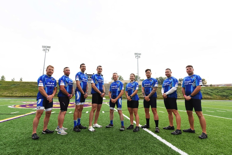 Members from Team Dakota and three different Air Force bases stand on a football field in Denison, Iowa, July 23, 2018. Team Dakota and the Air Force Cycling Team participated in the Register's Annual Great Bicycle Ride Across Iowa, where they rode roughly 460 miles, helped fix other participants' bikes, and supported Air Forces recruiting efforts. (U.S. Air Force photo by Airman 1st Class Thomas Karol)