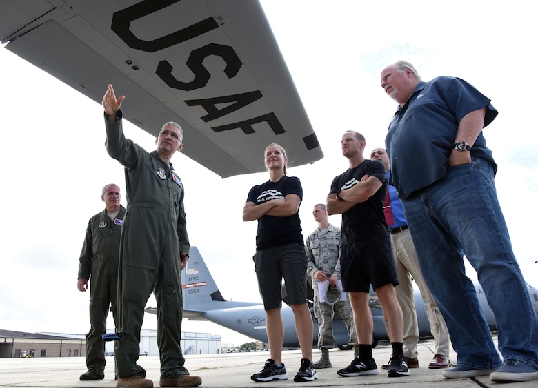 U.S Air Force Lt. Col. Jeffrey Ragusa, 53rd Weather Reconnaissance Squadron chief pilot, briefs Alpha Warrior members on the mission capabilities of a WC-130J Super Hercules on the flightline at Keesler Air Force Base, Mississippi, Aug. 2, 2018. The 81st Force Support Squadron and the Air Force Services Activity hosted the Alpha Warriors during a two-day visit which consisted of a tour of the base and an Alpha Warrior battle rig competition. (U.S. Air Force photo by Kemberly Groue)