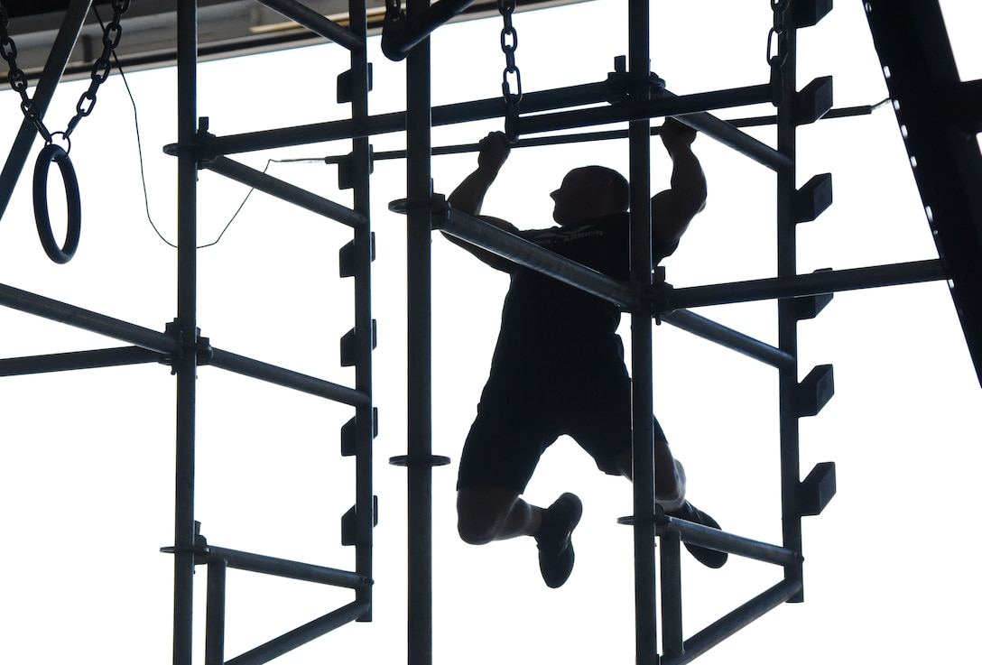 Kevin Klein, Alpha Warrior professional athlete, provides an obstacle demonstration inside Hangar Four on Keesler Air Force Base, Mississippi, Aug. 2, 2018. During the Alpha Warriors' two-day visit a competition was held for Airmen competing on the Alpha Warrior battle rig. (U.S. Air Force photo by Kemberly Groue)