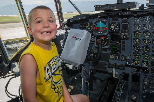 Noah Harder, son of Chaplain (Maj.) Todd Harder, 302nd Airlift Wing, sits in the flight deck of a C-130 Hercules aircraft during the 302nd AW's Family Day, Aug. 4, 2018, at Peterson Air Force Base, Colorado.  (U.S. Air Force photo by Staff Sgt. Amber Sorsek)