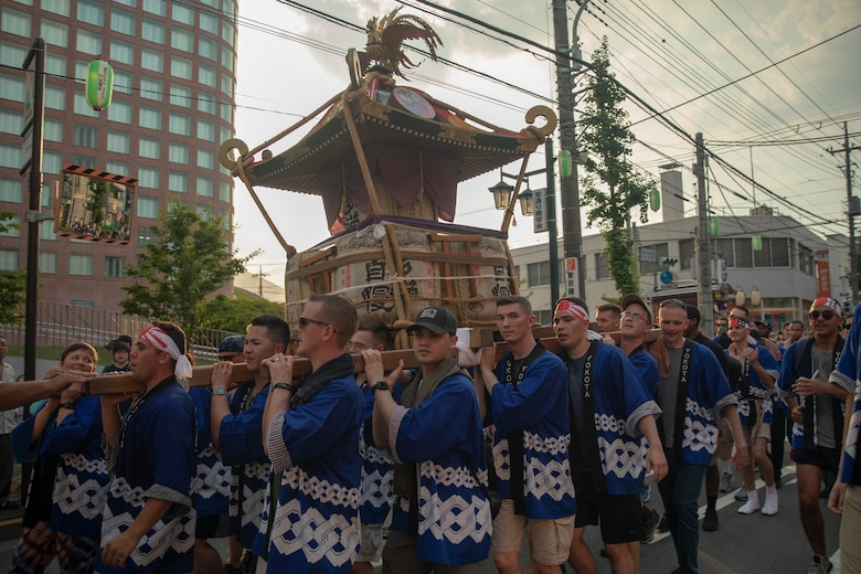 Members from Yokota Air Base carry the 374th Airlift Wing's official mikoshi during the 68th Annual Fussa Tanabata Festival at Fussa City,