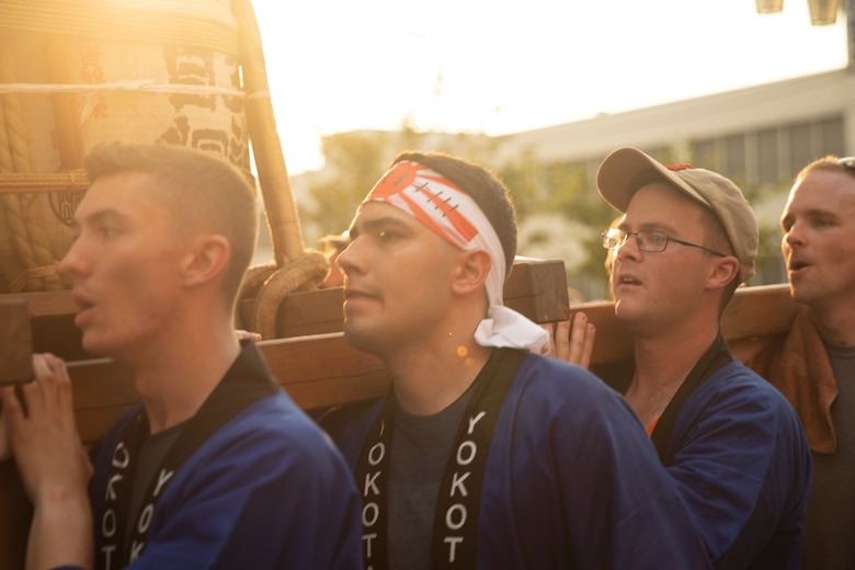 Members from Yokota Air Base carry the 374th Airlift Wing's official mikoshi during the 68th Annual Fussa Tanabata Festival at Fussa City