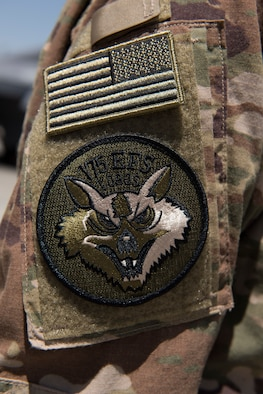 An airman from the 175th Expeditionary Fighter Squadron, South Dakota Air National Guard, wears the unit patch on his uniform while deployed to Bagram Airfield, Afghanistan, August 5, 2018. The 175th EFS are deployed from the 114th Fighter Wing, Joe Foss Field, Sioux Falls, in support of combat operations in Afghanistan. (U.S. Air Force photo by Tech. Sgt. Eugene Crist)