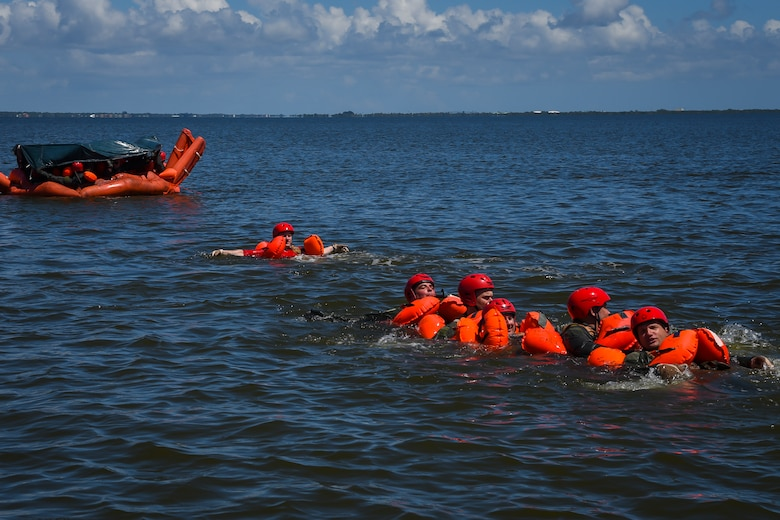 Aircrew from the 39th Rescue Squadron swim towards a life raft Aug. 4, 2018, during water survival training at Patrick Air Force Base, Florida.