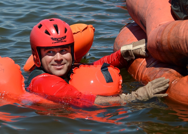 Technical Sgt. Jarrod Burgess, a 920th Operations Support Squadron Aircrew Flight Equipment, Life Support technician, demonstrates boarding a life raft Aug. 4, 2018 at Patrick Air Force Base, Florida.