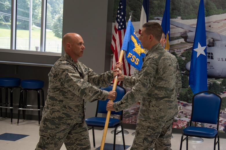Lt. Col. Christian Capece (middle) commits to taking command of the 130th Force Support Squadron from Lt. Col. Rick Thomas, 130th Mission Support Group Commander (left), as Lt. Col. David Lester (right) relinquishes command Aug. 5, 2018 at McLaughlin Air National Guard Base, Charleston, W.Va. Capece was formerly the 130th Airlift Wing's Staff Judge Advocate, which he served as for the last 10 years. (U.S. Air National Guard Photo by Capt. Holli Nelson)