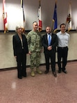 Leadership development program participants Daryl Puffinburger and Peter DeMattei pose with Maj. Gen. Michael Wehr, USACE Deputy Commanding General, during a visit to Headquarters USACE in Washington, D.C. Daniel Rivera is far right.