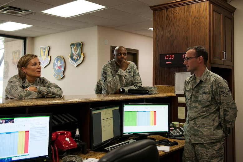 Col. Jennifer Short, left, 23d Wing (WG) commander, and Chief Master Sgt. James Allen, center, 23d WG command chief, talk with Airman 1st Class Alexis Rodriguez, 23d Operations Support Squadron (OSS) airfield manager, during an immersion, Aug. 6, 2018, at Moody Air Force Base, Ga. Wing leadership toured the 23d OSS to meet with Airmen and learn about the day-to-day operations and emergency weather procedures. Throughout their visit, Airmen shared with leadership their opinions and ideas for the continued success and improvement of the 23d OSS. (U.S. Air Force photo by Airman Taryn Butler)
