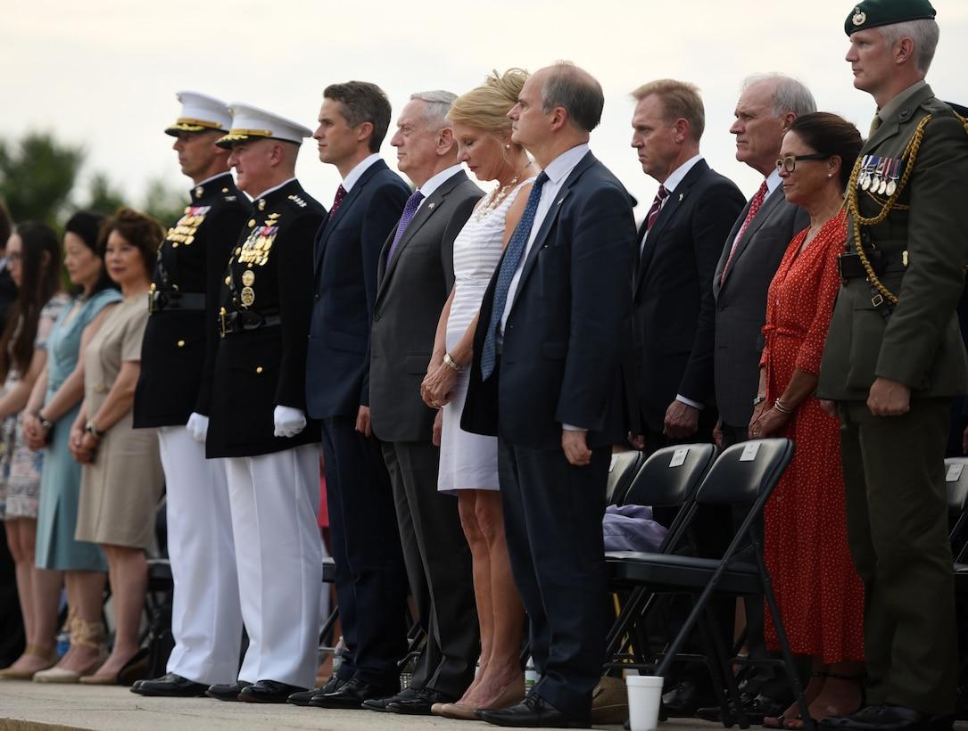 Defense Secretary James N. Mattis and British Defense Secretary Gavin Williamson stand at attention.