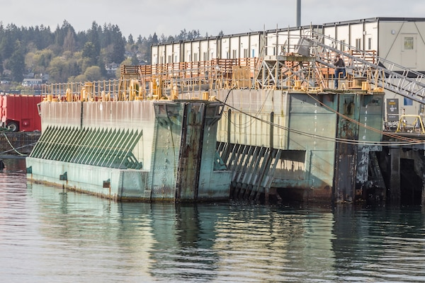 Historic caissons 2 and 3 seen at Puget Sound Naval Shipyard & Intermediate Maintenance Facility in Bremerton, Wash., in 2018. The watercraft are currently being offered for sale through the Defense Logistics Agency's disposition services.