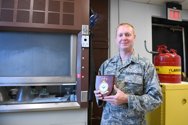 U.S. Air Force Staff Sgt. Jason Chipley, 145th Logistics Readiness Squadron, posed with a squadron plaque that he received from spending two weeks with the Royal Air Force in the United Kingdom as part of the Military Reserve Exchange Program at the North Carolina Air National Guard Base, Charlotte Douglas International Airport, August 5, 2018. During his trip, Chipley was embedded with members of the 4624 Squadron of the Royal Air Force where he presented briefings about the North Carolina Air National Guard and experienced their military culture.