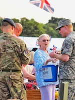 U.S. Air Force Staff Sgt. Jason Chipley (center), 145th Logistics Readiness Squadron, helps with collecting donations for a charity event during Battle Proms at Hatfield Park, Hatfield, United Kingdom, July 14, 2018. The Military Reserve Exchange Program not only allows military members to learn and exchange ideas about their respective career fields, but it also provides the opportunity to be immersed in the host country's culture.