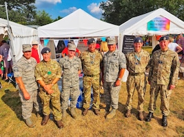 U.S. Air Force Staff Sgt. Jason Chipley (third from left), 145th Logistics Readiness Squadron, poses with members from the United States Air Force Reserves and Royal Air Force during Battle Proms at Hatfield Park, Hatfield, United Kingdom, July 14, 2018. The Military Reserve Exchange Program not only allows military members to learn and exchange ideas about their respective career fields, but it also provides the opportunity to be immersed in the host country's culture.