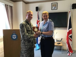 U.S. Air Force Staff Sgt. Jason Chipley, 145th Logistics Readiness Squadron, receives a squadron plaque from the commanding officer of the 4624 Squadron Royal Air Force Reserves, Oxfordshire, United Kingdom, July 19, 2018. The Military Reserve Exchange Program provides National Guard and Reserve Participants training associated with mobilization duties while enhancing their ability to work and communicate with military individuals of the host nation.