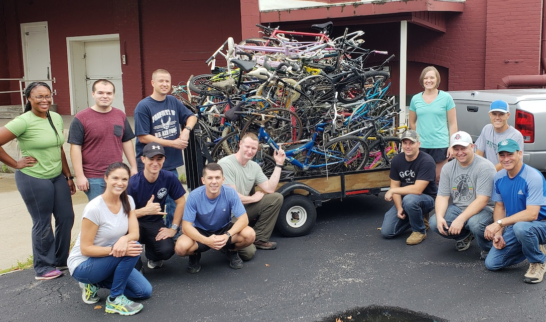 Members of the 655th Intelligence, Surveillance and Reconnaissance Group's, 14th Intelligence Squadron, proudly pose after loading 1,400 pounds of scrap bicycle materials at Bicycles for All, Dayton, Ohio, July 20, 2018.