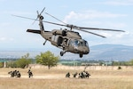 A Georgia Army National Guard UH-60 Black Hawk from the Marietta based, 1st Battalion, 171st Aviation Regiment, lifts off rapidly after inserting Georgian special forces during an urban operations exercise at the Vaziani Training Area on Aug 5, 2018, during Noble Partner 18.  The exercise highlights the 24 years the two militaries have worked together under the U.S. National Guard's State Partnership Program.