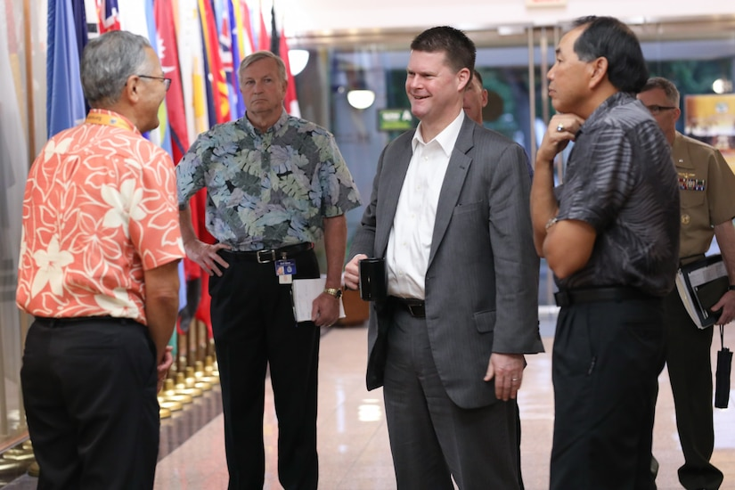 A DOD official meets with personnel from the Asia-Pacific Center for Security Studies.