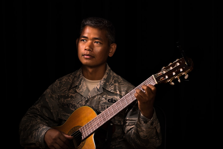 U.S. Air Force Tech. Sgt. Daniel Santos, U.S. Air Force Heritage Band of America guitarist, poses for a photo at Joint Base Langley-Eustis, Virginia, Aug. 1, 2018.