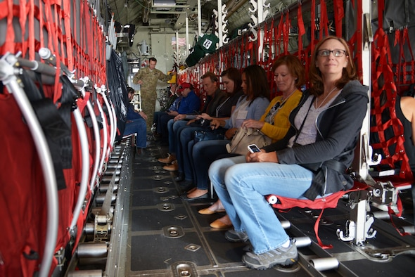 Civilian employers take their seats aboard a C-130 Hercules aircraft and await  takeoff  Aug. 3, 2018, at Peterson Air Force Base, Colorado. Employers of Air Force reservists were invited to attend Employer Appreciation Day to get a snapshot of the  reserve mission at the 302nd Airlift Wing,  Peterson AFB. (U.S. Air Force photo by Staff Sgt. Justin R. Norton)