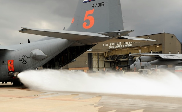 Loadmasters assigned to the 302nd Airlift Wing conduct a wet fire test of the U.S. Department of Agriculture Forest Service's Modular Airborne Fire Fighting System installed onto one of the Reserve wing's C-130 Hercules aircraft at Peterson Air Force Base, Aug. 8, 2018.