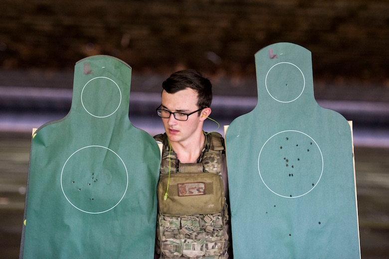 Senior Airman Jeffrey Lewis, 822d Base Defense Squadron fireteam leader, carries targets back after the shooting competition portion of the Defender Challenger assessment, July 30, 2018, at Moody Air Force Base, Ga.  Seven Moody defenders trudged through a gauntlet that tested their capability, lethality and readiness. Ultimately, only Lewis had the scores, determination and perseverance to advance to the next level for a chance to represent Air Combat Command during the 2018 Defender Challenge, Sept. 8-14, at Joint Base San Antonio-Camp Bullis, Texas. (U.S. Air Force photo by Airman 1st Class Erick Requadt)