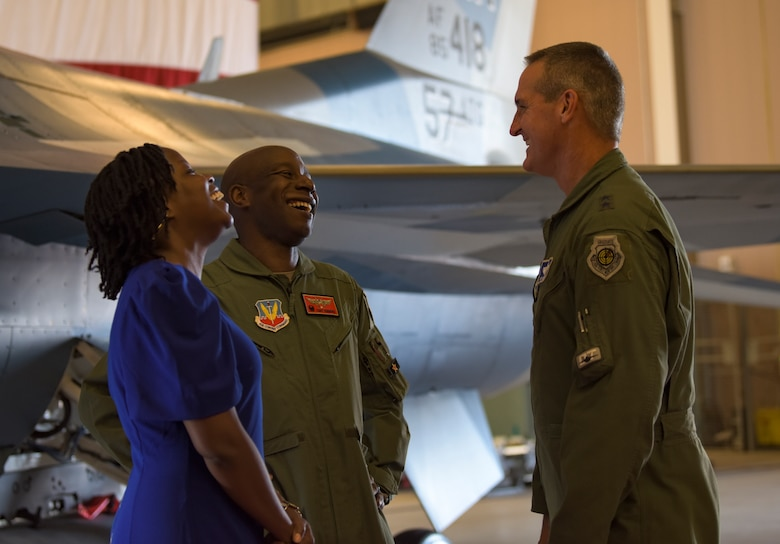 Maj. Gen. Peter Gersten, U.S. Air Force Warfare Center commander, greets Col. Travolis Simmons, 57th Advanced Tactics Group commander, and his wife, Mrs. Simmons, after a change of command ceremony at Nellis Air Force Base, Nevada, Aug. 8, 2018. The 57th ATG prepares the military to win our nation's war by providing leaders who know, teach and replicate the enemy. (U.S. Air Force photo by Airman 1st Class Andrew D. Sarver)