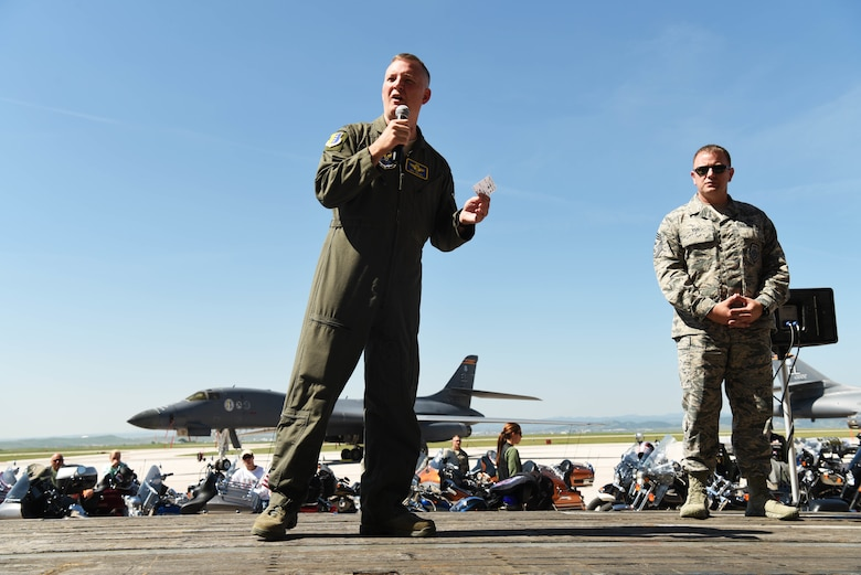 Col. Eric Hresko, the 28th Bomb Wing vice commander, addresses the participants of the Dakota Thunder Run at Ellsworth Air Force Base, S.D., Aug. 7, 2018. Over 150 participants rode 53 miles from Ellsworth AFB to the Sturgis Motorcycle Rally, where they helped kick off Military Appreciation Day events. (U.S. Air Force photo by Airman 1st Class Thomas Karol)