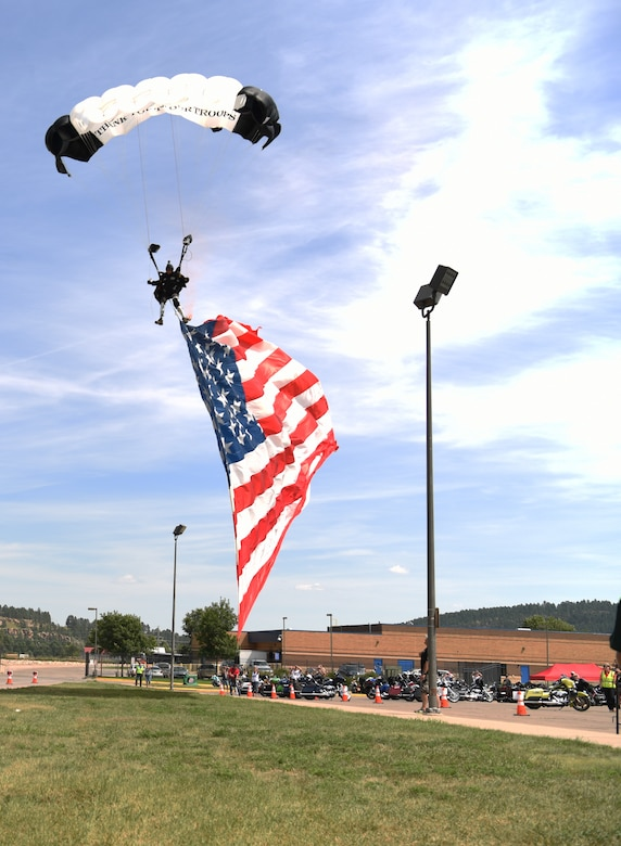 Retired Army 1st Sgt., Dana Bowman, a former Golden Knight parachute team member, skydives to the ground at Sturgis, S.D., Aug. 7, 2018. Bowman is a disabled veteran who lost both his legs while serving his country. He continues to skydive as a way to honor veterans and those who continue to serve. (U.S. Air Force photo by Airman 1st Class Thomas Karol)
