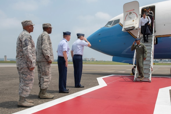 Lt. Gen. Jerry P. Martinez, U.S. Forces Japan and Fifth Air Force commander, salutes Gen. CQ Brown, Jr., Pacific Air Forces commander, upon his arrival to Yokota Air Base, Japan, Aug. 6, 2018.