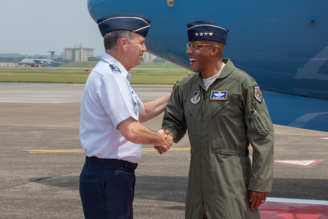Lt. Gen. Jerry P. Martinez, U.S. Forces Japan and Fifth Air Force commander, shakes hands with Gen. CQ Brown, Jr., Pacific Air Forces commander, upon his arrival to Yokota Air Base, Japan, Aug. 6, 2018.