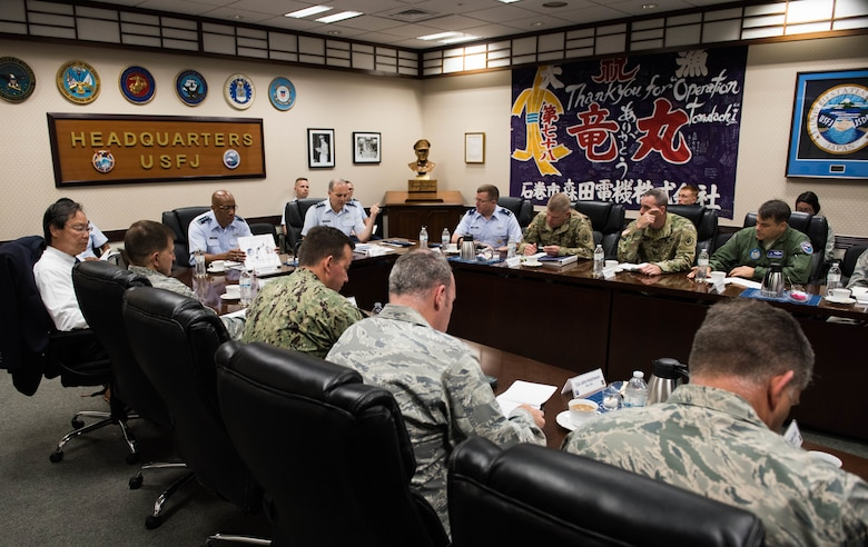 Gen. CQ Brown, Jr., Pacific Air Forces commander, meets with Lt. Gen. Jerry Martinez, U.S. Forces Japan and Fifth Air Force commander, and members of his key staff at Yokota Air Base, Japan, Aug. 6, 2018. Brown met with U.S. and Japanese defense and military leadership as part of his first visit to the region. (U.S. Air Force photo by Staff Sgt. Hailey Haux)