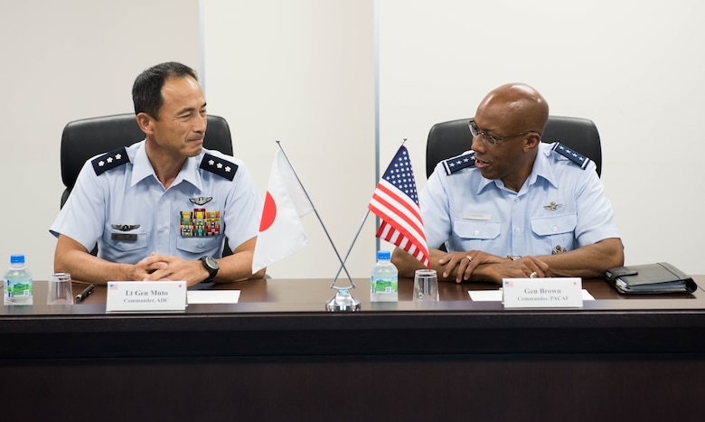 Gen. CQ Brown, Jr., Pacific Air Forces commander, and Lt. Gen. Shigeki Muto, Air Defense Command (ADC) commander, discuss opportunities to enhance cooperation and coordination during his visit to Yokota Air Base, Japan, Aug. 6, 2018. While at the ADC headquarters, the general observed a ballistic missile defense demonstration. (U.S. Air Force photo by Staff Sgt. Hailey Haux)