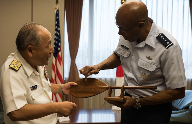 Gen. CQ Brown, Jr., Pacific Air Forces commander, presents a gift to ADM Katsutoshi Kawano, Japanese Chief of Joint Staff, after an office call with him at the Ministry of Defense in Tokyo, Japan, Aug. 7, 2018. Brown visited the country to affirm the United States' shared commitment to a free and open Indo-Pacific as well as to seek opportunities to enhance cooperation and coordination across the alliance. For more than 60 years, the U.S.-Japan alliance has been the cornerstone for stability and security in the region. (U.S. Air Force photo by Hailey Haux)