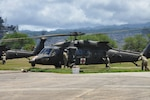 Two Black Hawk helicopters refuel at the 3rd Battalion, 25th Aviation Regiment, 25th Combat Aviation Brigade, 25th Infantry Division's Forward Arming and Refueling Point on Ford Island in Pearl Harbor, Hawaii, July 12. The helicopters are transporting patients in the mass casualty portion of the humanitarian assistance and disaster relief exercise during Rim of the Pacific 2018. Photo by Connie Braesch.