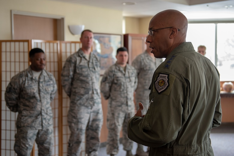 Gen. CQ Brown, Jr., Pacific Air Forces commander, takes a moment to speak with some of the 374th Airlift Wing's outstanding performers at Yokota Air Base, Japan, Aug. 8, 2018. This was Brown's first trip to the region since taking command on July 26, 2018.