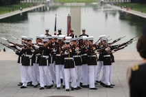 """Marines with the U.S. Marine Corps Silent Drill Platoon execute their """"bursting bomb"""" sequence during a Tuesday Sunset Parade at the Lincoln Memorial, Washington D.C., Aug. 7, 2018. The guest of honor for the parade was the Right Honourable Gavin Williamson, MP Secretary of State for Defence of the United Kingdom and the hosting official was Gen. Glenn M. Walters, assistant commandant of the Marine Corps."""
