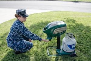 A sailor operates a mosquito trap.