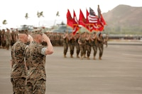 U.S. Marine Corps Lt. Gen. David H. Berger, left, outgoing commander of U.S. Marine Corps Forces, Pacific, and Lt. Gen. Lewis A. Craparotta, incoming commander of MARFORPAC, salute the colors as they pass in review during the MARFORPAC change of command ceremony at Marine Corps Base Hawaii, Aug. 8, 2018. The change of command ceremony represents the transfer of responsibility and authority over MARFORPAC between commanders.