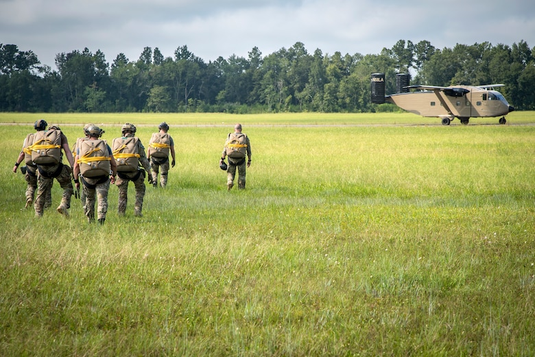 Pararescuemen (PJ) from the 38th Rescue Squadron (RQS), walk en-route to board a Short SC-7 Skyvan, July 24, 2018, in Valdosta, Ga. PJs performed static-line jumps to maintain their jump proficiency qualifications. The mission of the 38th RQS is to employ combat ready rescue officers and pararescuemen to support units worldwide. (U.S. Air Force photo by Airman 1st Class Eugene Oliver)
