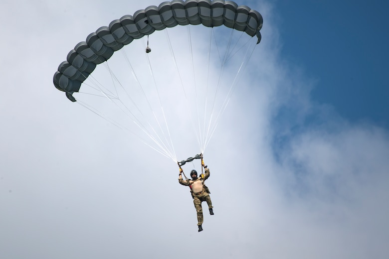 A Pararescueman from the 38th Rescue Squadron, descends after conducting a static-line jump from a Short SC-7 Skyvan, July 24, 2018, in Valdosta, Ga. PJs performed static-line jumps to maintain their jump proficiency qualifications. The mission of the 38th RQS is to employ combat ready rescue officers and pararescuemen to support units worldwide. (U.S. Air Force photo by Airman 1st Class Eugene Oliver)