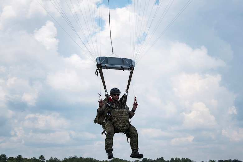 A Pararescueman (PJ) from the 38th Rescue Squadron (RQS), drifts towards the ground, July 24, 2018, in Valdosta, Ga. PJs performed static-line jumps to maintain their jump proficiency qualifications. The mission of the 38th RQS is to employ combat ready rescue officers and pararescuemen to support units worldwide. (U.S. Air Force photo by Airman 1st Class Eugene Oliver)