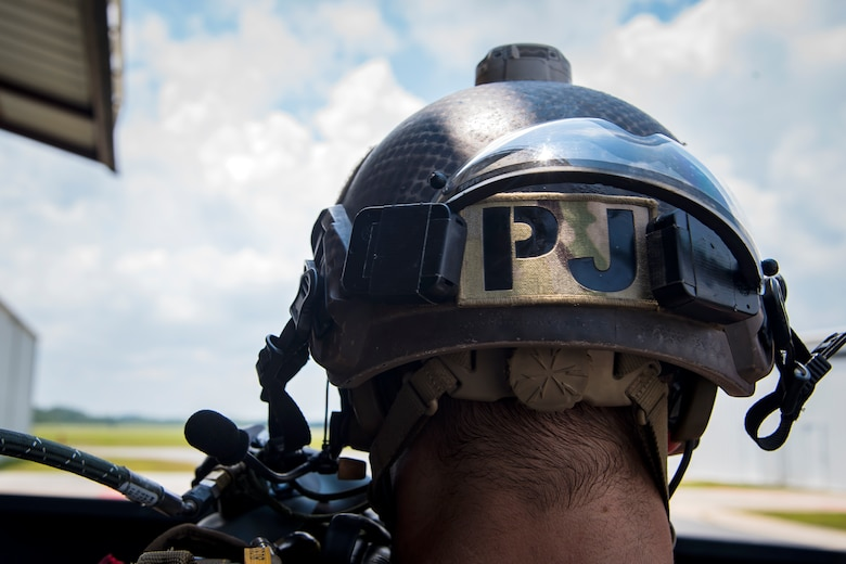 A Pararescueman (PJ) from the 38th Rescue Squadron (RQS), sits in a truck prior to a static-line jump, July 24, 2018, in Valdosta, Ga. PJs performed static-line jumps to maintain their jump proficiency qualifications. The mission of the 38th RQS is to employ combat ready rescue officers and pararescuemen to support units worldwide. (U.S. Air Force photo by Airman 1st Class Eugene Oliver)