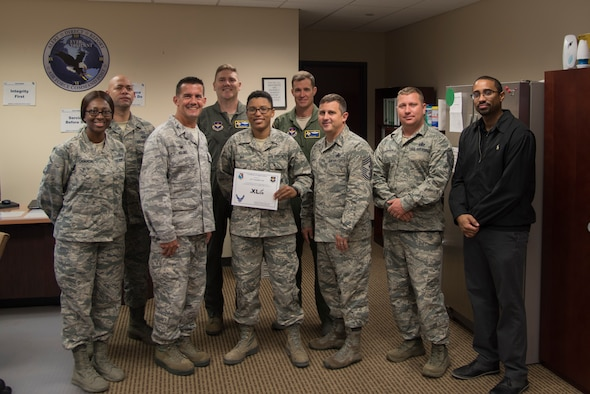 "Airman 1st Class Nachelle Vail, 47th Flying Training Wing emergency actions controller, was chosen by wing leadership to be the ""XLer"" of the week, for the week of July, 30, 2018, at Laughlin Air Force Base, Texas. The ""XLer"" award, presented by Col. Charlie Velino, 47th Flying Training Wing commander, is given to those who consistently make outstanding contributions to their unit and the Laughlin mission. (U.S. Air Force photo by Airman 1st Class Daniel Hambor)"