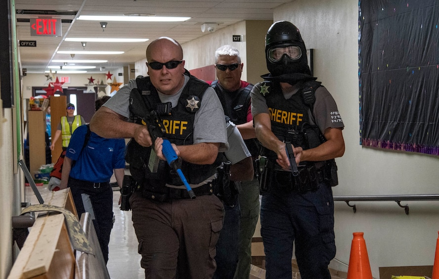 Local law enforcement participate in an active shooter exercise July 24, 2018, at Whiteside Elementary School, Belleville, Illinois. By developing and rehearsing a comprehensive active shooter plan, leadership can better protect their employees from an active shooter incident.
