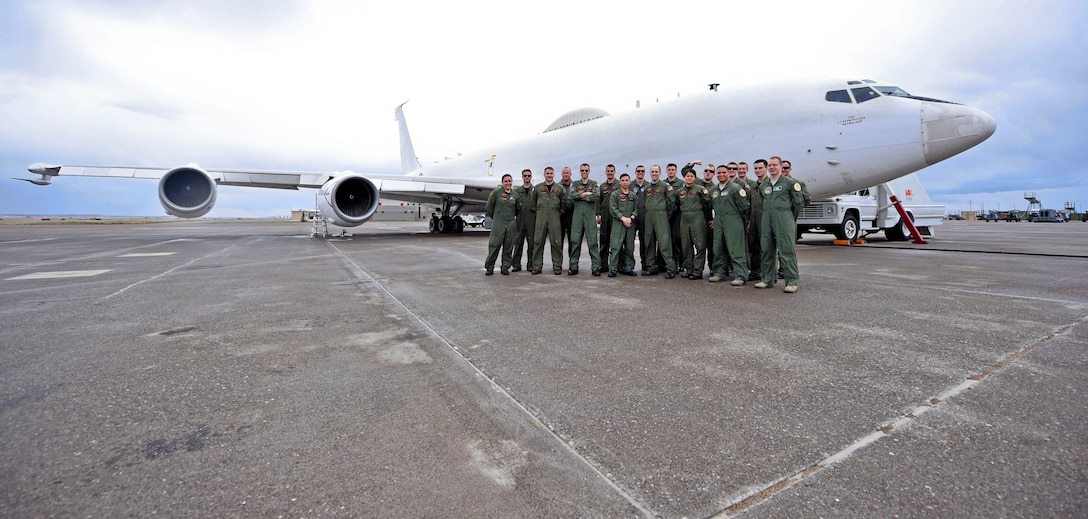 The joint Air Force and Navy crew of an E-6B Mercury Airborne Launch Control System aircraft, stationed with the 625th Strategic Operations Squadron based out of Offutt Air Force Base, Neb., pose for a picture on the tarmac of the Montana Air National Guard flight line in Great Falls, Mont., April 5, 2016. Col. Jonathan Sorbet took over July 2 as senior materiel leader for a division of the Command, Control, Communications, Intelligence and Networks Directorate at Hanscom Air Force Base, Mass. responsible for acquiring the Family of Advanced Beyond Line-of-Sight Terminals, or FAB-T, used on the E-6B. (U.S. Air Force photo by Airman Collin Schmidt)