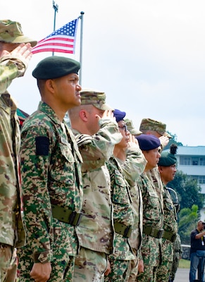 Officers from the 96th Troop Command, Washington Army National Guard, and the 15th Royal Malay Regiment, 3rd Division, Malaysian Army, salute during the closing ceremony of Exercise Keris Strike 2018, Aug. 3, 2018. Keris Strike 2018 is a bilateral exercise between the U.S. and Malaysia that focuses on humanitarian disaster relief efforts.